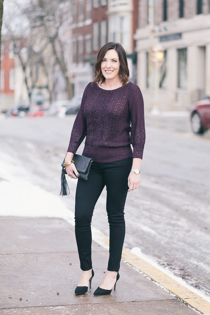 New Year's Eve party outfit with White House Black Market plum sequined pullover, black AG skinny jeans, and suede d'orsay pumps.