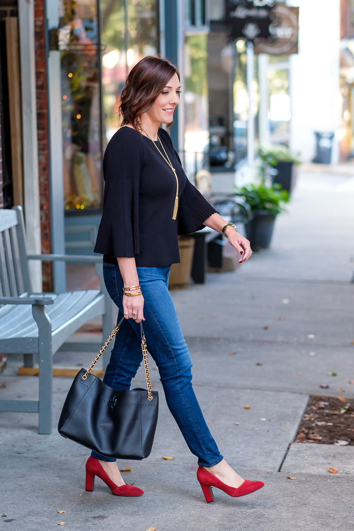 Red shoes are a big trend right now, and today I'm styling a classy fall date night look with red suede pumps and a gorgeous black pleated sleeve top.