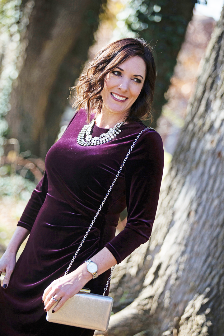 What to wear to a company holiday party -- this festive velvet dress with a glittery statement necklace and sparkly heels is perfect holiday style!