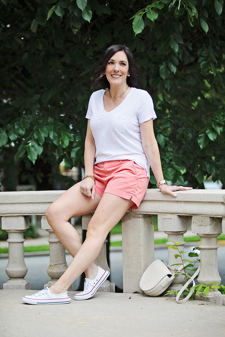 Jo-Lynne Shane wearing a casual summer outfit with Old Navy Pixie chino shorts, Madewell Whisper cotton v-neck pocket tee, and Converse Shoreline kicks. #momfashion #summerstyle #outfitinspo