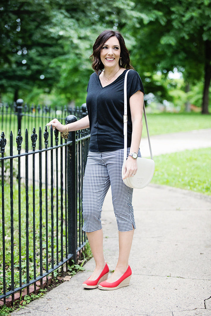 Wondering how to wear pedal pushers this summer? Loving this summer outfit with gingham pedal pushers, a black top, and red espadrille wedges!