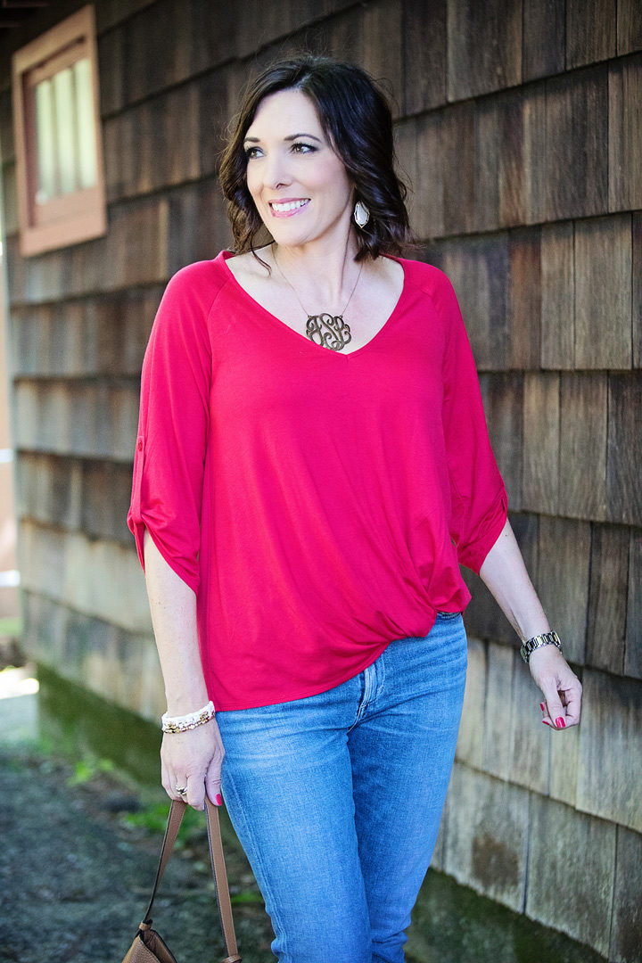 Jo-Lynne Shane wearing Gibson tab sleeve knot waist top with Love Always monogram pendant necklace