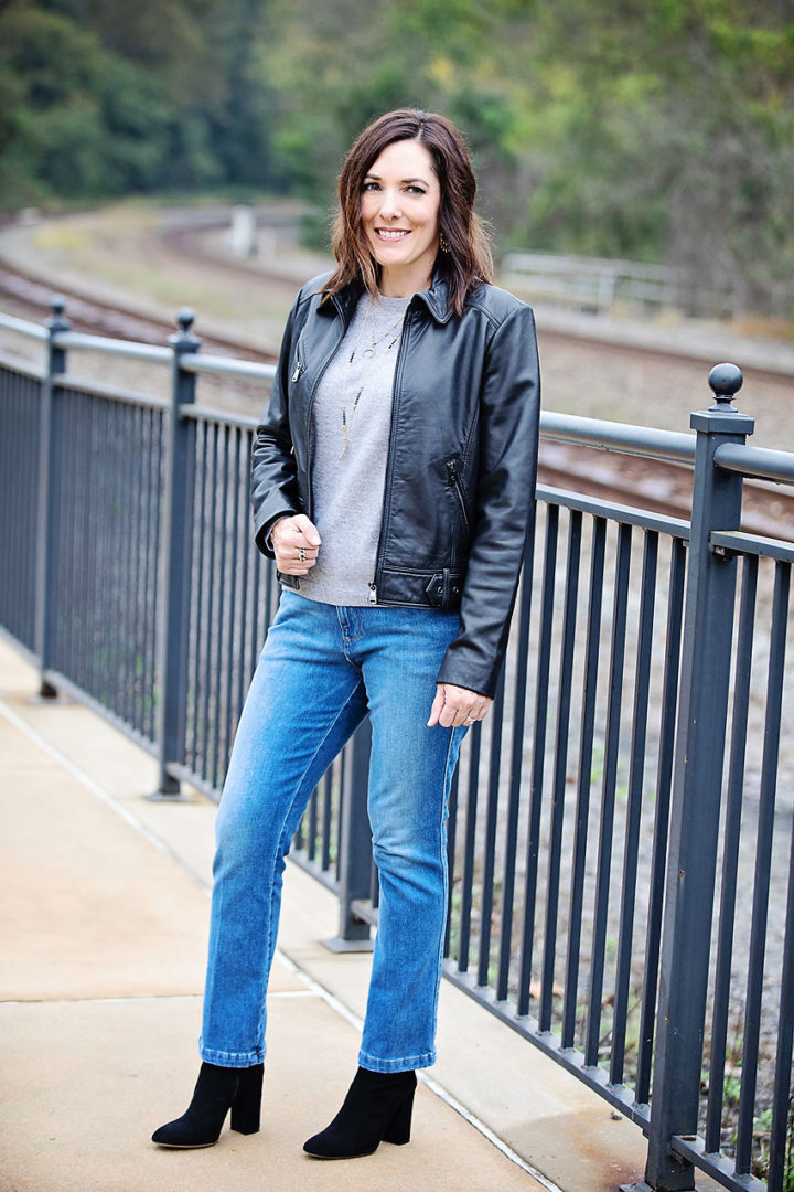 Jo-Lynne Shane wearing Frame Le Slender Straight ankle jeans with Club Monaco black sock booties, Vince crewneck cashmere sweater, and Bernardo leather jacket