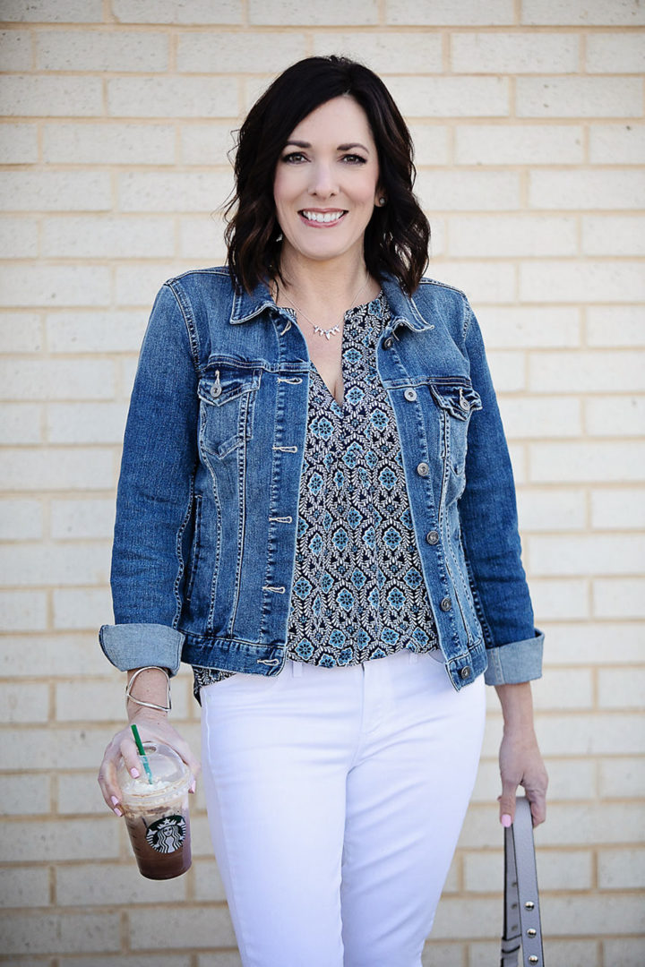 Jo-Lynne Shane wearing Two by Vince Camuto denim jacket with LOFT Geo Mixed Media Split Neck Shell, and Paige Verdugo white skinny jeans