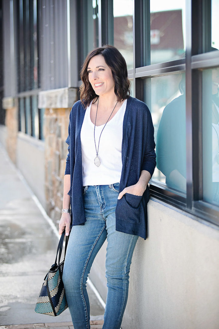 Jo-Lynne Shane wearing Bobeau Rumor Dolman-Sleeve Cardigan with BlankNYC Classic Stretch Jeans and Lucky Brand Modern Opulence Gunmetal-Tone Pave Agate Necklace