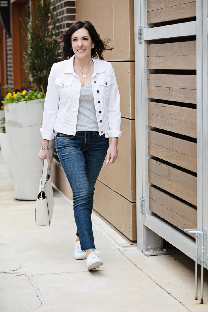 This casual outfit is made of some of my favorite spring wardrobe basics -- white denim jacket, grey v-neck tee, Rag & Bone skinnies, and Veja sneakers!