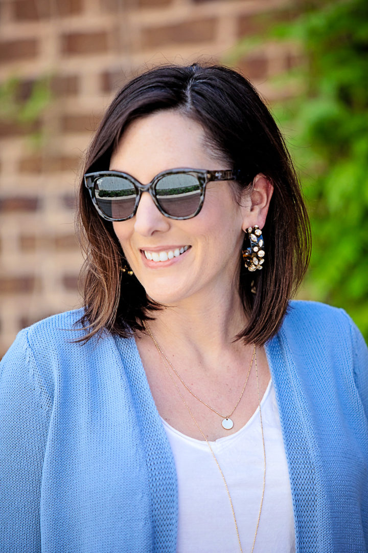 Jo-Lynne Shane wearing LOFT Earth Month Shirttail Open Cardigan, J.Crew Crystal and tortoise hoop earrings, and Maui Jim Mele PolarizedPlus2 Round Cat Eye Sunglasses