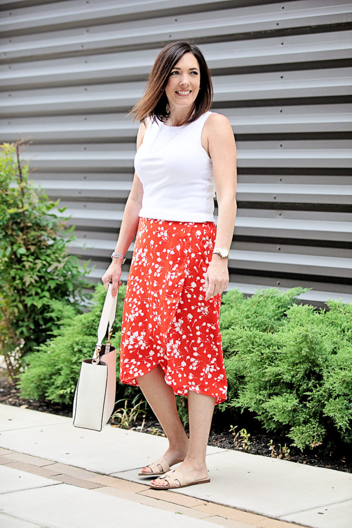 Summer Midi Skirt Outfit with J.Crew Factory Faux-Wrap Pull-On Midi Skirt in Fantome Floral Ivory Red Print | also wearing: J.Crew Factory Open-Neck Cami Top and Nine West Gianna Cut-Out Slides | Fashion over 40 with Jo-Lynne Shane