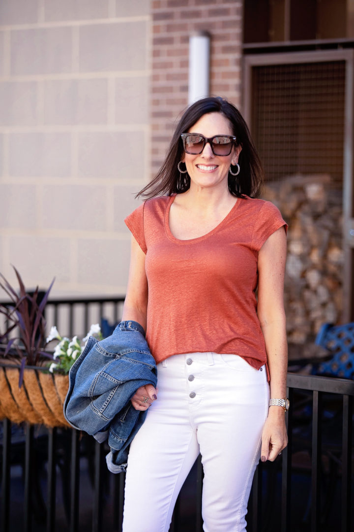 fall white jeans outfit with a rust-colored linen tee