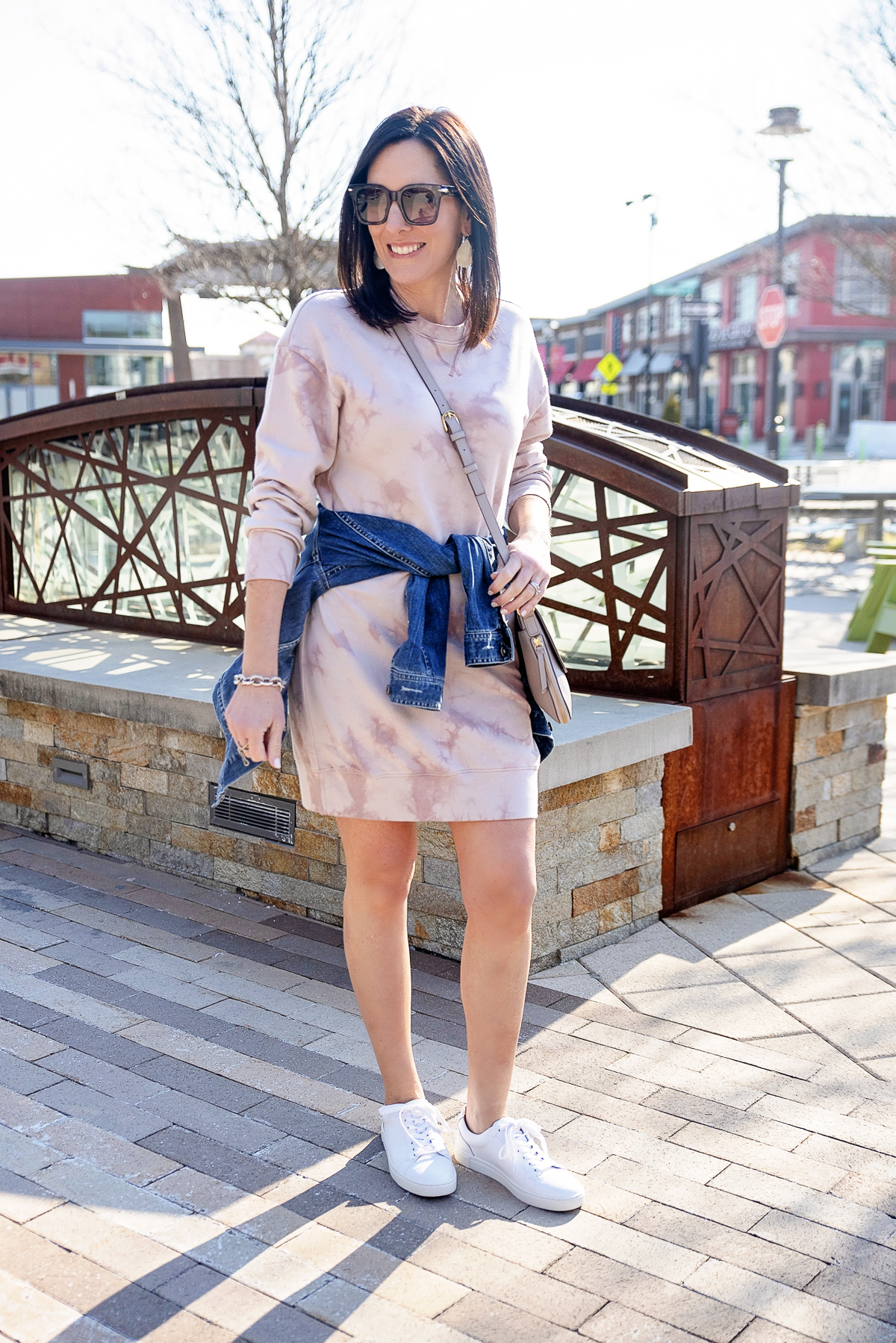 casual sweatshirt dress outfit for spring with Old Navy tie-dyed sweatshirt shift dress and Vince Camuto denim jacket